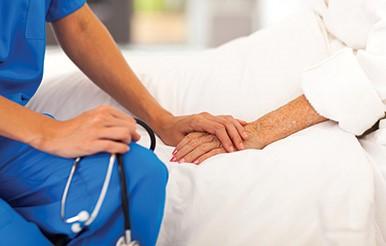 Nurse comforts patient, Shrewsbury Hospital, Shropshire